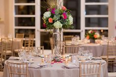 This rustic chic fall wedding at Stonehouse was given a boho twist with pops of pink, orange, white and green for our bride and groom!