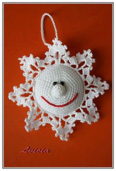 Crocheted Smiling Snowflake Ornament - just a visual inspiration as no pattern available / Brenda's Bric-a-Brac