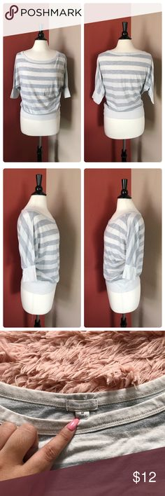 "Zenana Outfitters White & Gray Dolman Top Zenana Outfitters white & gray stripe top. Size M. Dolman style sleeves. Very lightweight and airy. The material is not stretchy, but the fit is quite baggy or oversized. Some wear, a bit of piling can be seen in picture #4. Great casual or lazy day item - lots of life still left! No other flaws.  Measurements are taken laying flat & are appx Bust • 46"" Length • 22.5"" Condition • Good Materials • 75% polyester, 17% cotton, 8% linen Zenana Outfitters…"