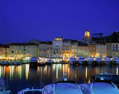 Côte d'Azur, France, Europe: St. Tropez harbor at the town's favorite time of day: night.