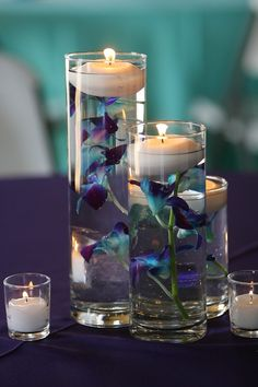 Simple DIY blue orchid flowers in vase floating candle centerpieces - 2015 Christmas wedding glass candle holders