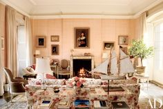 In the home's pink living room, John Singer Sargent's 1882 Miss Beatrice Townsend hangs above the mantel, which displays a Jean Schlumberger jeweled tree.
