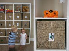 stephmodo: Playroom Storage usig Ikea shelves, Ikea baskets and photos mounted on baskets. Ikea Basket, Wicker Baskets, Playroom Storage, Playroom Ideas, Kid Toy Storage, Tote Storage, Storage Ideas, Ikea Expedit, Expedit Bookcase