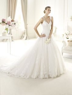 """""""URI. More on www.pronovias.com"""" They've done it again. This dress is such a beautiful combination of tulle and lace detail."""