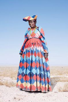 An elderly woman of Namibia's Herero tribe wearing a patchwork dress. Photographs by Jim Naughten
