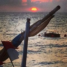 Our dinner view - lovely sunset on the special holiday for the locals - many people watching the sunset go down in the beach tonight! #upsticksandgo #senggigi #sunset #lombok #indonesia #theoffice #dinnerview #travelgram #travellingtheworld #travelphotos | Flickr - Photo Sharing!