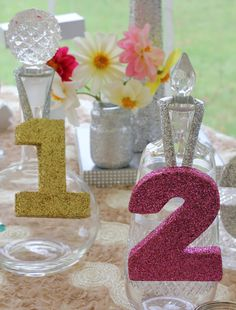 Glitter table numbers on decanters