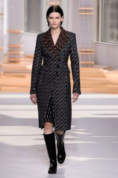 Jason Wu seems to have settled in quite nicely at Boss. And perhaps the brand's German-ess—order and structure—has rubbed on him, helping him evolve beyond some of the overt femininity that won him acclaim and a spot in the First Lady's wardrobe.    - HarpersBAZAAR.com