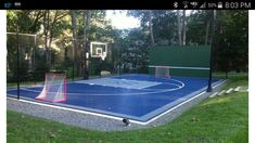 Multi-sport court - half court bball, hockey nets, tennis net that is on pols to raise up for volleyball and back wall for racquetball - awesome!!