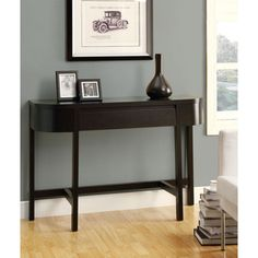 @Overstock.com - Cappuccino 48-inch Accent Console Table - This elegant wood console table features table-top space and a center drawer to let you reduce clutter in your home. It comes in a dainty cappuccino finish to suit any style of decor, while its solid wood construction ensures it stands the test of time.  http://www.overstock.com/Home-Garden/Cappuccino-48-inch-Accent-Console-Table/6811421/product.html?CID=214117 $152.32