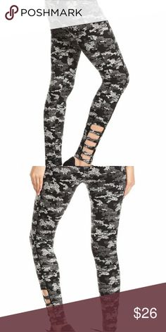 Soft Camo Cutout Bottom Leggings Black & White Camo Print, Skinny fit w/ wide waistband and detailed ankle cris cross cutouts. 94% Polyester, 6% Spandex. Pants Leggings