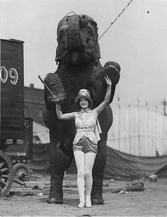 Hand in hand in hand, 1930s circus elephant and his lovely show companion