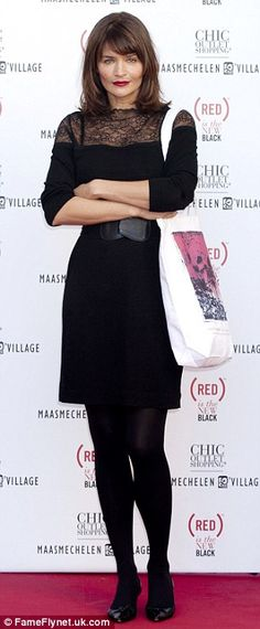 Lady in black: The 43-year-old supermodel wore a long-sleeved dress with opaque tights and low heels