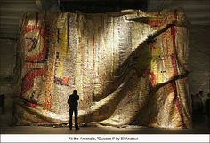 El Anatsui  Dusasa I    Ghanian-born El Anatsui constructs large-scale, quilt-like sculptures comprised entirely of the aluminum wrappings from liquor bottles. The works take on this incredible life as it folds and ripples, mimicking a textile.
