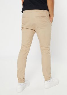 A pair of khaki twill pants featuring a zip ankle, pockets, and a drawstring waist. Khaki Joggers, Khaki Pants, Twill Pants, Buy One Get One, Camo Print, Drawstring Waist, Latest Trends, Ankle, Zip