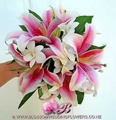 Orchids and pink star gazer lilies, I like.