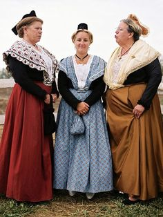 Photograph by Dan Peretz    Women in Provence, France, wear traditional dresses for a memorial gathering.