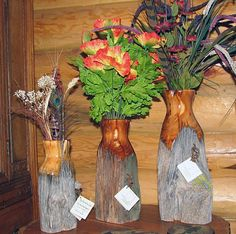 """Fence Post Vases, these vases are made up of old fence post. """"No color or stain is used just the natural beauty of the wood"""""""