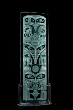 Glass Art, Pacific NW.  Haida Lineage Totem - 6ft.  Geoff Greene in Skidegate, Queen Charlotte Islands, British Columbia.  Haida Nation.  Glass; Etched and sandblasted, Edition of 45.  Geoff belongs to the Raven and the Eagle Clans.
