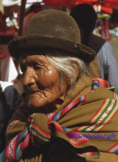 This old woman, dressed in traditional Bolivian style, was shopping at the market in Calacoto, Bolivia.