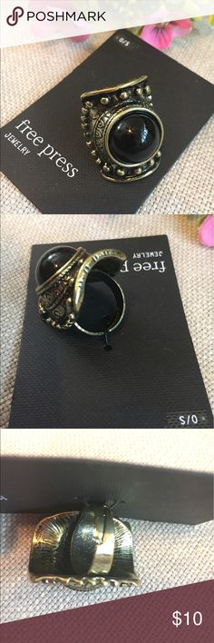 🆕 Free Press Adjustable Statement Ring This Free Press Statement Ring is new with tags and never worn. Size O/S as ring is adjustable. This brass looking Ring is the perfect accessory for Summer! I absolutely love the bold black center stone! Very edgy and yet boho chic! Free Press Jewelry Rings