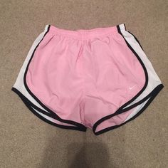 Pink Nike running shorts Very good condition. Light pink, white on sides, black trim, Nike, dri-fit running shorts. Nike Shorts, Nike Running Shorts, Gym Shorts Womens, Pink And Black Nikes, Pink Nikes, Pink White, Nike Dri Fit, Runs Nike, Gym Outfits