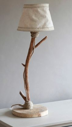 Table lamp from driftwood and rope