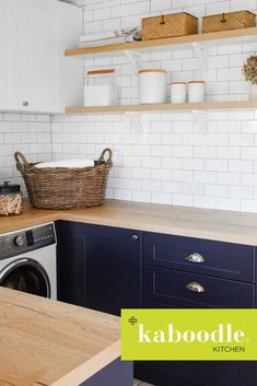 Laundry love! We're just loving this inspired laundry space in collaboration with @homebeautiful brought to life with our bluepea cabinetry and the timber-tones of our hazelnut benchtop. And did you notice the matching shelves, created from our hazelnut benchtop to complete the look? . . . #kaboodlekitchen #kaboodle #laundry #laundrydesign #bluepea #hazelnut #laundrylove