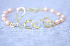 Love bracciale wire wrapped fatto a mano di SusyDeMarchiJewelry, €16.50