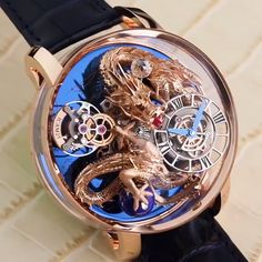 The Astronomia Dragon features a hand crafted dragon that's spins with the movement if the watch. Best Skeleton Watches, Best Watches For Men, Luxury Watches For Men, Stylish Watches, Cool Watches, Rolex Watches, Unique Watches, Patek Philippe, Gold Dragon