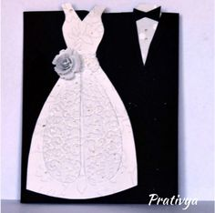 Want a unique card that is bound to be loved by the couple on their special day?   This handmade greeting card featuring a bride and groom dress is sure to be a hit!