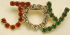"Eisenberg ""JOY"" Brooch - Done in red, green and clear rhinestones, this would work either if your name is Joy or if you simply want to express your feelings about the holidays. 1 3/4"" x 3/4"" Z"