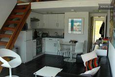 Open plan kitchen area, underfloor heated tiles, stairs leading up to the mezzanine bedroom