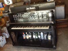 "Repurposed piano into custom ""piano bar""."