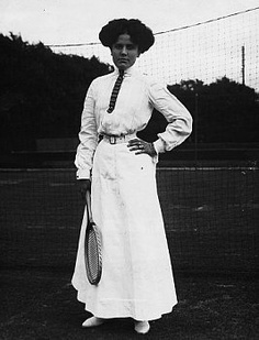 1912 Dora Boothby (winner at Wimbledon in 1909) wearing her corseted tennis outfit.