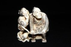 """Chinese Carved Polychrome Ivory Group Netsuke. Depicting man , woman and octopus. Measures - 2"""" high."""
