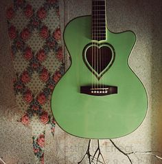 Heart hole custom green acoustic guitar! sooo cute!!!!! love the color