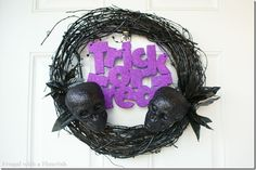 All these items can be bought at the dollar store. use a hot glue gun and SHABAMM!! a creative halloween door wreath! :)