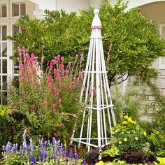 Easy Garden Trellis instructions from Lowe's... uses 3 fan shaped trellises, clay pot, and finial ball