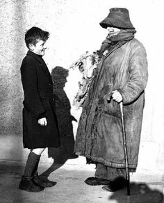 """""""Forty Coats, how many coats ye wearin' today?"""" - Forty Coats chatting to a young lad in Dublin, February, 1943 (Independent Newspapers) Colourised by Pearse Ireland Pictures, Old Pictures, Old Photos, Irish People, Young Lad, Al Capone, Photo Engraving, Dublin City, National Archives"""