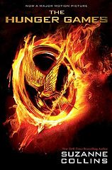 The Hunger Games by Suzanne Collins.   In a future North America, where the rulers of Panem maintain control through a televised survival competition pitting young people against one another, Katniss's skills are put to the test when she takes her younger sister's place.