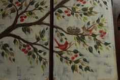 Close up shot of painted cupboard doors of branches, with cherries and cardinals.  Picture taken before antique process was done.