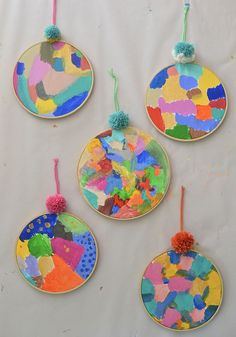 Children learn about acrylic paints by just digging in and experimenting on…