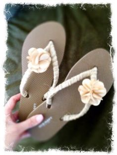 Old Navy flip flops: $2.50, Embellishments (twine-ribbon & flowers): $5.99 = DIY, why not? :) cute for bridesmaids