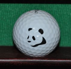 Panda Bear logo golf ball. Titleist. Ball is in good condition. Impact mark on the top of the face. The logo is excellent. The ball pictured is the ball for sale.