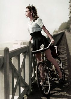 colorized phozo of Susan Peters atop her Monark bicycle, 1943