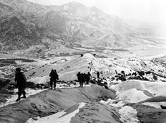 Infantry of the 19th Regiment, 24th Division, in retreat 10 miles south of Seoul, Jan. 3, 1951. (U.S. Army photo)