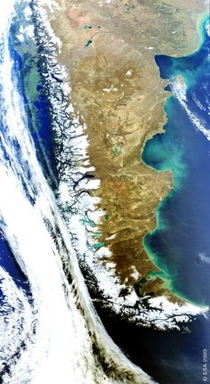 Patagonia satellite image with cloud formations. A sparsely populated region located at the southern end of South America, shared by Argentina and Chile. The region comprises the southern section of the Andes mountains as well as the deserts, steppes and grasslands east of this southern portion of the Andes. The area's principal economic activities have been mining, whaling, livestock (sheep), agriculture (wheat & fruit), and oil.