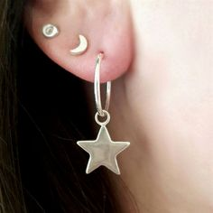 Contemporary sterling silver hoop earrings with a Star charm drop.Lovingly wrapped in tissue paper and presented in our white and gold branded gift box. The Star is a wishful symbol, said to bring…MoreMore #SilverJewelry