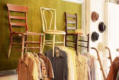old wooden chairs used for clothing rack. Put on the wall by the door with the mirror.